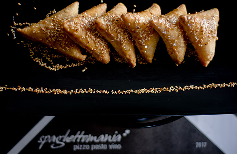 Honey pies with cheese and sesame