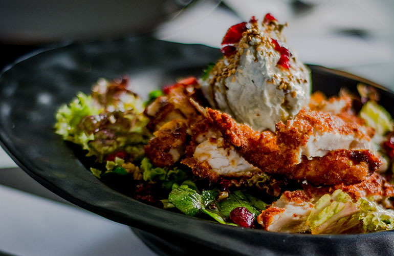 Americana Salad with breaded chicken, lola, cranberries, blue cheese and orange