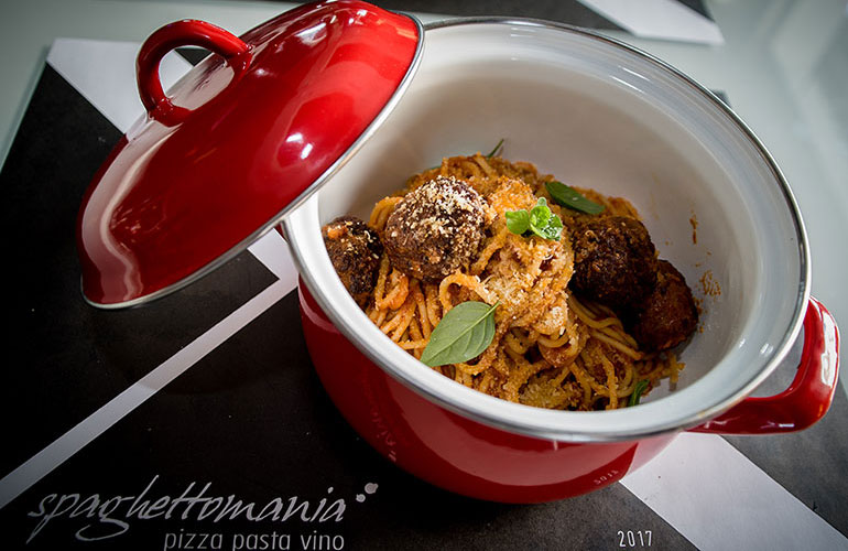 Spaghetti with aromatic meatballs served in tomato sauce
