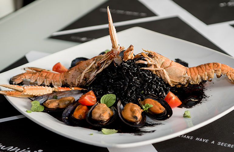Risotto with mussels and crayfish served with crayfish ink